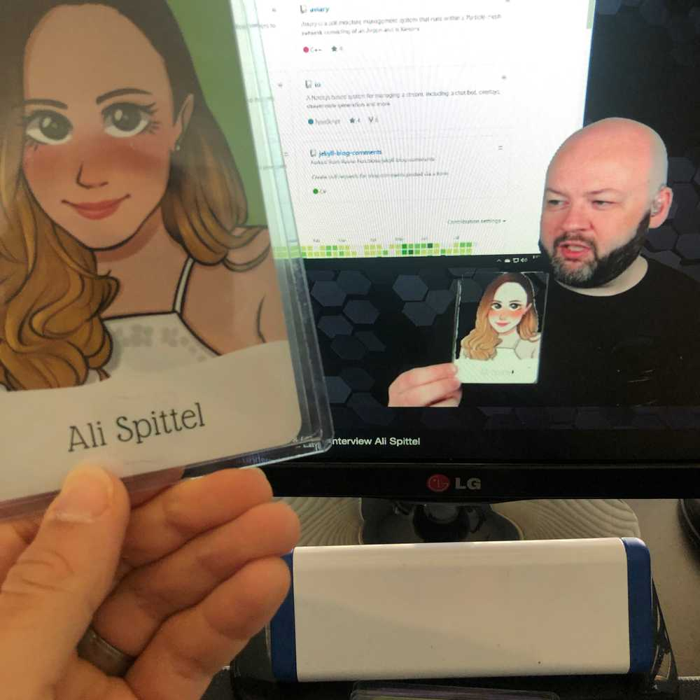 Mike Jolley on stream while holding up a card